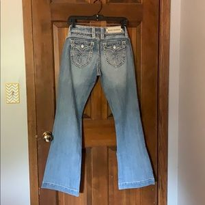 Light wash rock revival jeans.